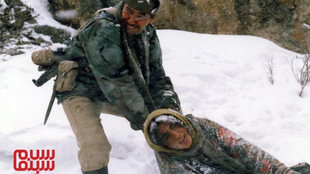 پارسا پیروزفر و گلشیفته فراهانی در برف- بهترین فیلم های عاشقانه جنگی ایرانی